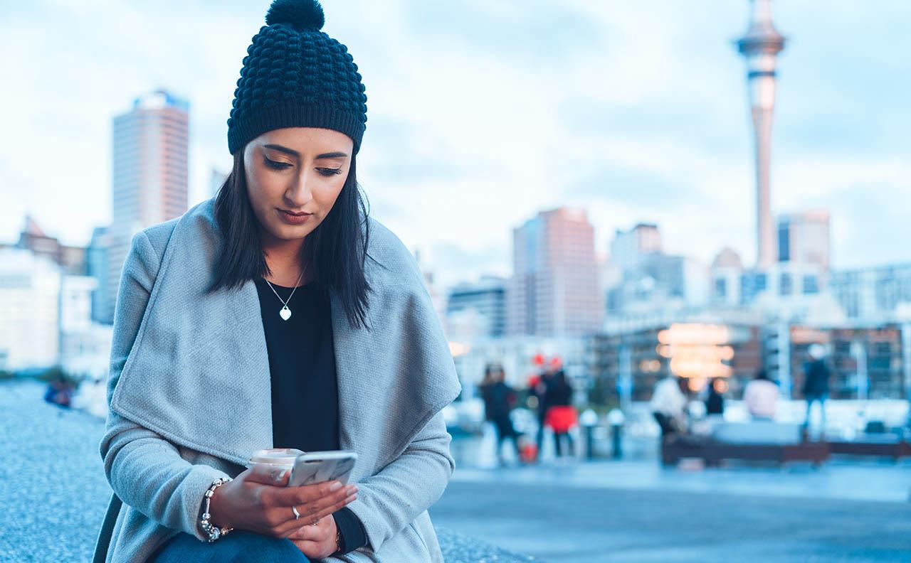 woman checking social media Auckland New Zealand